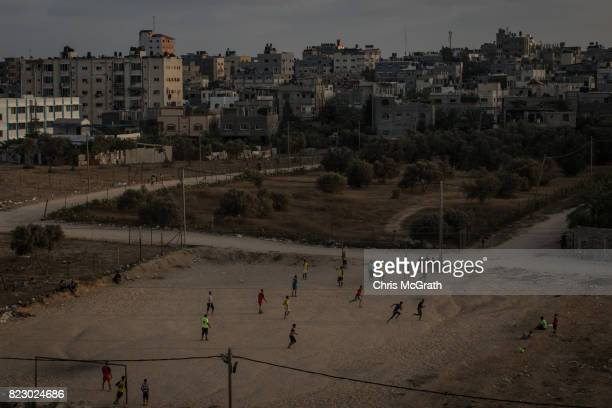 Men are seen playing football in the Nusseirat district on July 19 2017 in Gaza City Gaza For the past ten years Gaza residents have lived with...