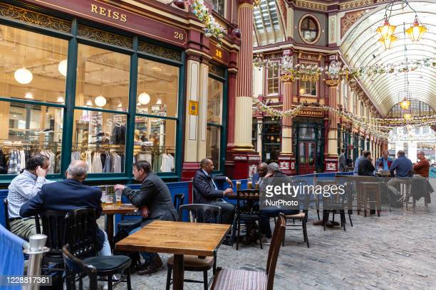 Men are seen relaxing in a pub in the Leadenhall Market in The City of London, largely abandoned as the second wave of Coronavirus hits London on...