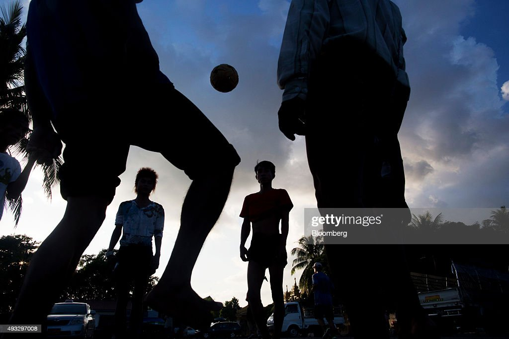 Men are silhouetted as they play caneball, a traditional sport known in Myanmar as chinlone, in Yangon, Myanmar, on Thursday, Oct. 15, 2015. Myanmar's government signed a cease-fire agreement with half of the nation's armed ethnic groups, a partial victory for President Thein Sein less than a month before an historic national election. Photographer: Brent Lewin/Bloomberg via Getty Images