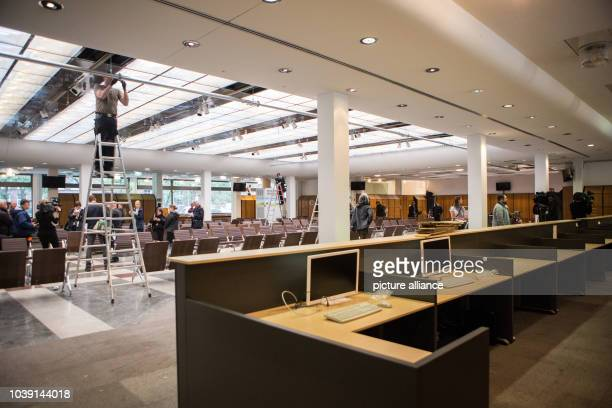 Men are still at work in the central waiting area of the new reception centre for refugees and asylum seekers in Berlin Germany 14 October 2015 The...