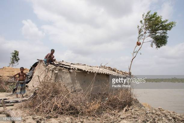 Men are trying to repair their broken houses which has been destroyed in the super cyclone Amphan