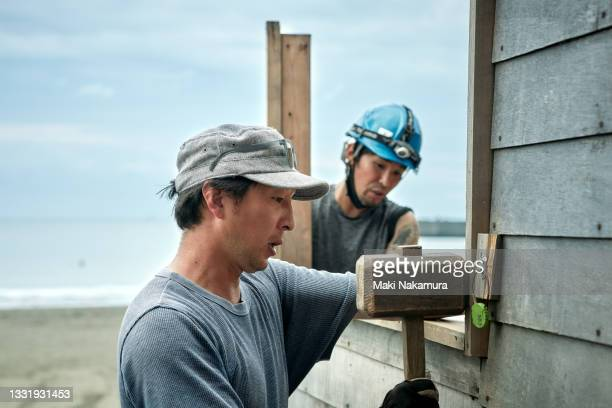 men are working on the construction site - chigasaki stock pictures, royalty-free photos & images