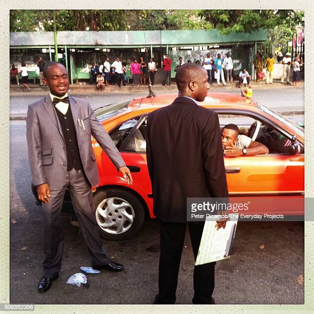 Men argue over the cost of a taxi ride as the workday ends in the Plateau neighborhood of Abidjan Ivory Coast on January 15 2013