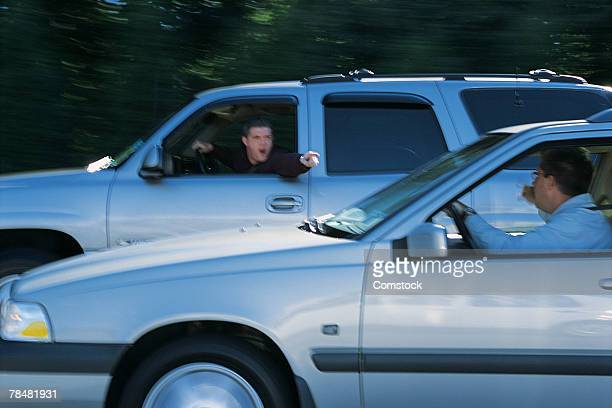 Men arguing with each other from their vehicles while driving