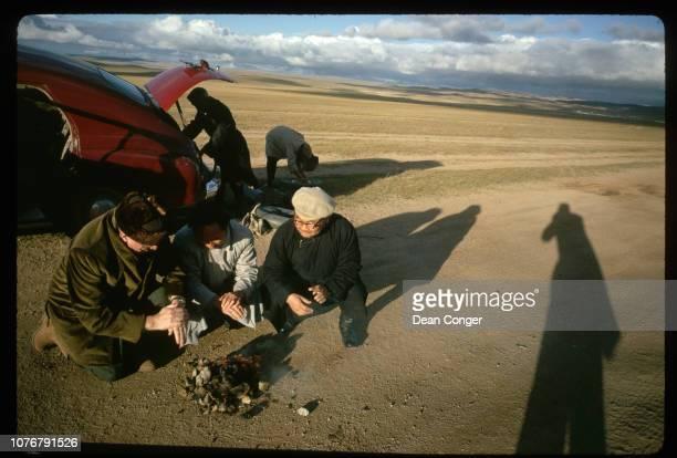 Men Around Fire on Rural Mongolian Road