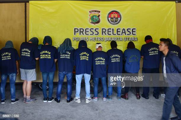 Men arrested in a recent raid stand in line during a press conference at a police station in Jakarta on May 22 2017 Indonesian police have detained...