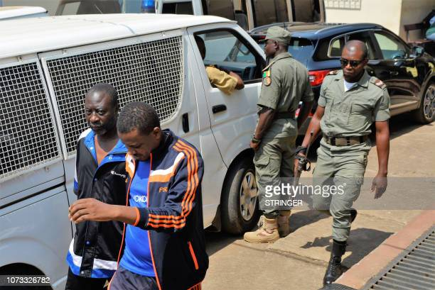 Men arrested in connection with Cameroon's anglophone crisis are seen at the military court in Yaounde, Cameroon, on December 14, 2018. - Nearly 300...