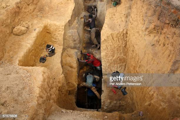 Men ascend from a pit in a cobalt mine where about 4,000 artisan miners dig on December 13, 2005 in Ruashi mine about 20 kilometers outside...