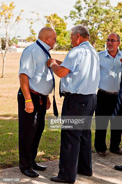 men assiting in making a tie knot - merten snijders - fotografias e filmes do acervo