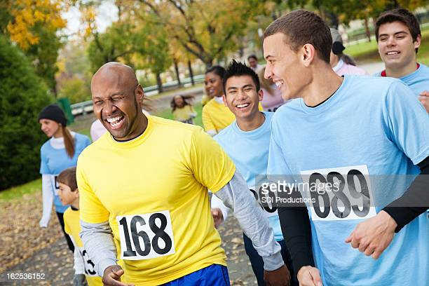 Men at a charity race laughing together