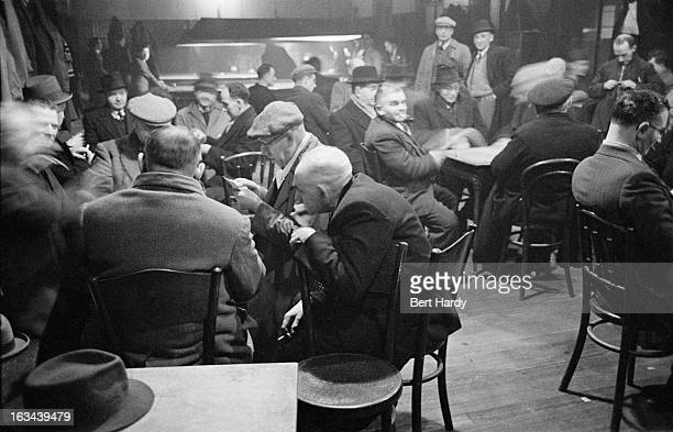 Men at a social club in the Gorbals, a slum district of Glasgow, 1948. Original publication: Picture Post - 4499 - The Forgotten Gorbals - pub. 31st...