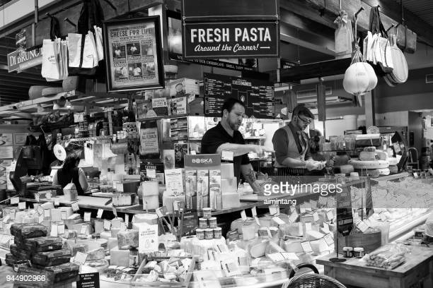 men at cheese stall in farmer's market - ardmore pennsylvania stock pictures, royalty-free photos & images