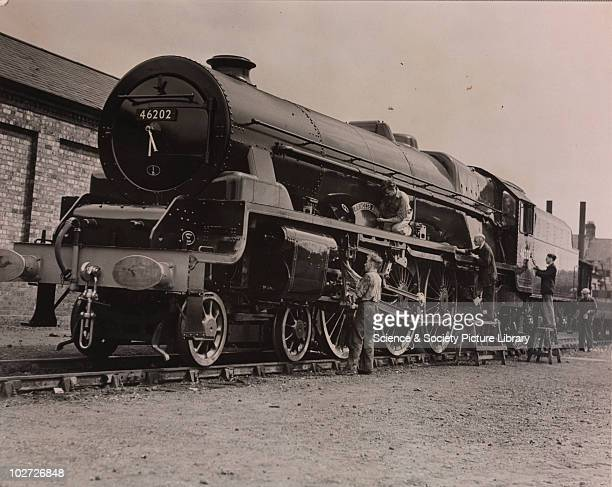 Men at Crewe Locomotive Works fixing name plate of the Princess Anne