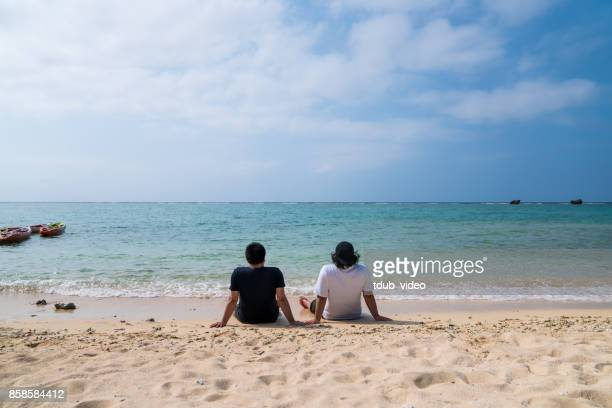 men at okinawa beach - tdub_video stock pictures, royalty-free photos & images