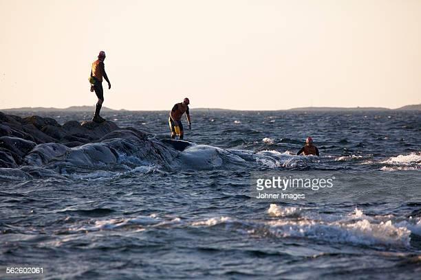 Men at rocky coast