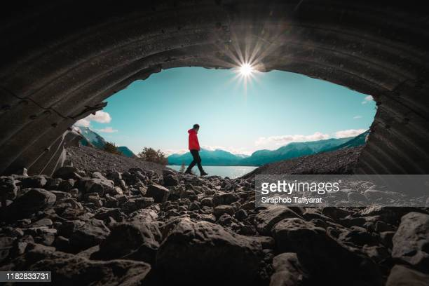 men at secret cave canada abraham lake - wide shot stock pictures, royalty-free photos & images