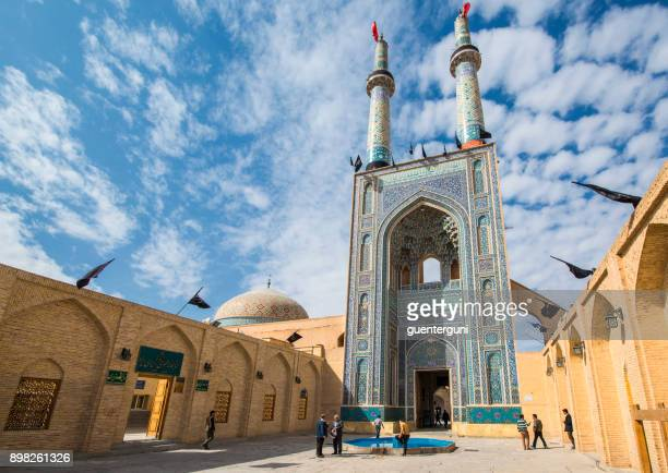 men at the entrance of jame (or friday) mosque, yazd, iran - iranian culture stock photos and pictures