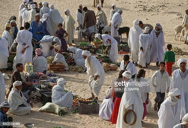 Men at the market in El Khoubna between Touggourt and El Oued Algeria