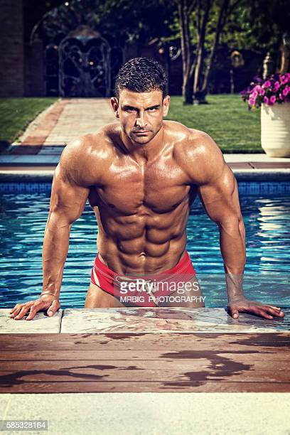 men at the swimming pool - manhood stock photos and pictures