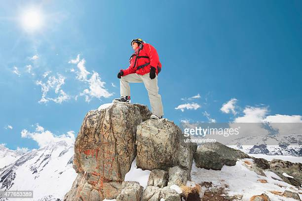 Men at the top of a mountain