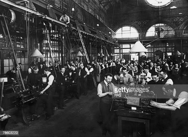 Men at work in a factory, circa 1900.