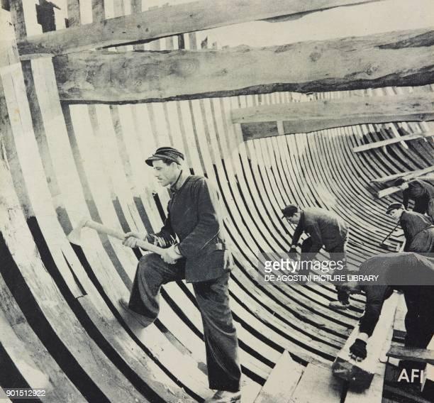 Men at work in a shipyard Italy World War II from L'Illustrazione Italiana Year LXX No 45 November 7 1943