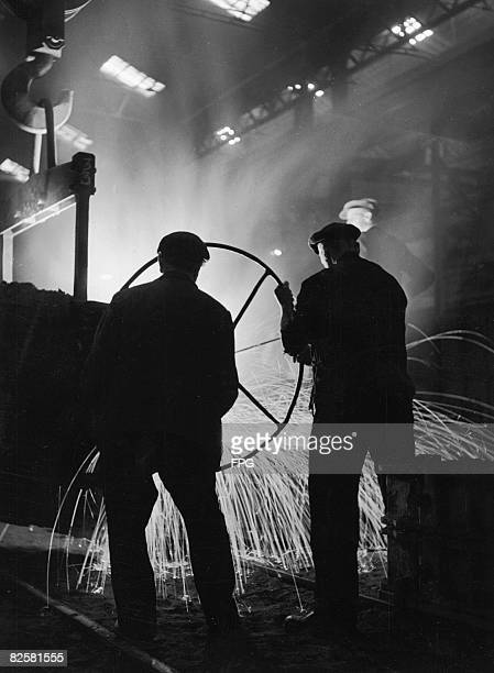 Men At Work In Steel Mill