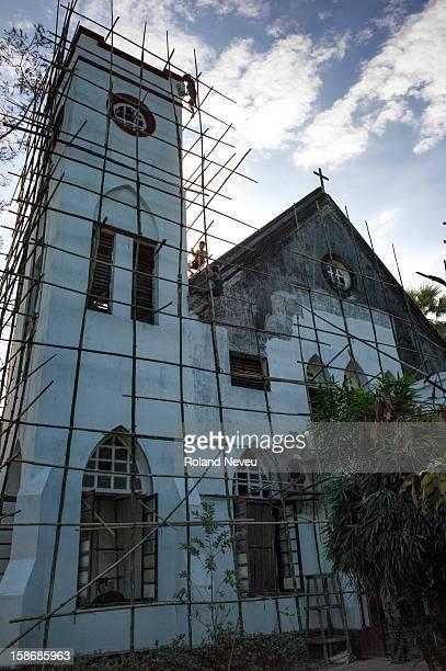 Men at work on bamboo scafoldings to renovate a catholic church in Mawlamyine