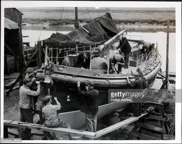 Men at work on the RNLB lifeboat 'Sir Edward Z Dresden' which took part in the evacuation of Dunkirk World War II It is now undergoing repairs in...