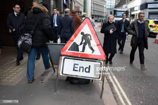 Men at work sign in the City of London on 28th January 2020 in London, England, United Kingdom. The City of London is a historic financial district,...
