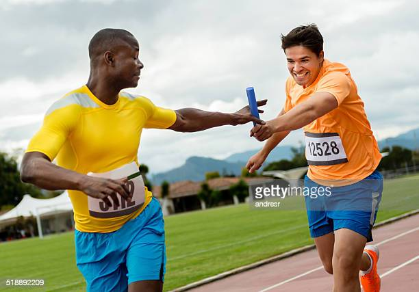 Men athletes in a relay race