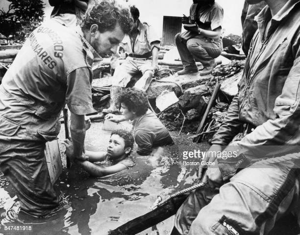 Men attempt to rescue Omaira Sanchez who is trapped in debris from the eruption of Nevado del Ruiz Volcano in Armero Columbia on Nov 15 1985 She died...