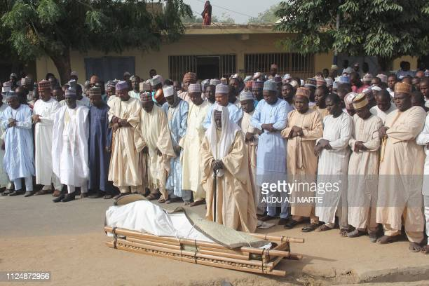 TOPSHOT Men attend the burial prayer of a victim of a suspected Boko Haram attack in Maiduguri on February 14 2019 In an incident on the campaign...