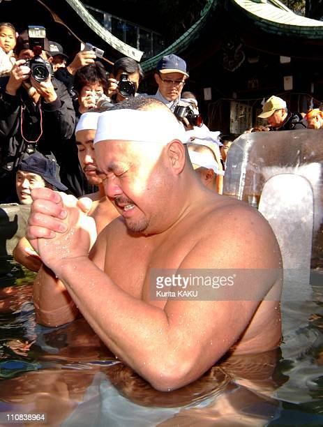Men Bathe In Ice Water At TeppozuInari Shrine In Tokyo Japan On January 09 2005 Men bathe in ice water at TeppozuInari shrine in Tokyo on January 9...