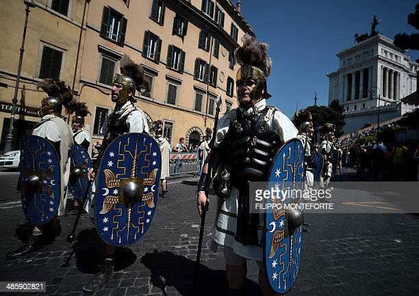 Men belonging to historical groups march dressed as ancient Romans in Rome to mark the anniversary of the legendary foundation in 753 BC of the...