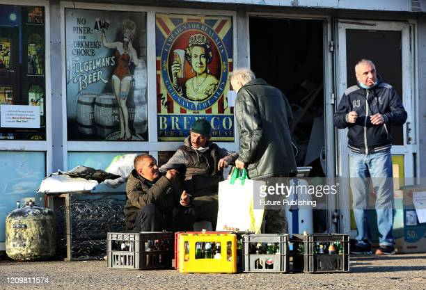 Men bring empty glass bottles to a recycling station as the Ukrainian capital is in quarantine amid the COVID-19 pandemic, Kyiv, capital of Ukraine....