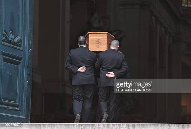 Men bring into SaintRoch church the coffin of French actress Maria Schneider for a funeral ceremony at on February 10 2011 in Paris Schneider who...