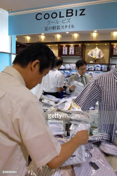 "Men browse shirts at a ""Cool Biz"" clothing display at a Mitsukoshi department store in downtown Tokyo Friday, July 1, 2005."