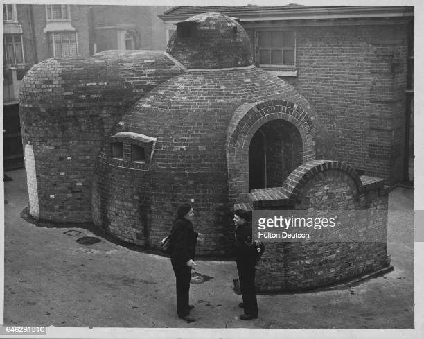 ARP Men Build Blast Proof Control Pump This igloo shaped building said to be completely blast proof has been built by men of the Central Wandsworth...