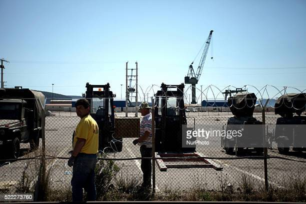 Men building the camps fence Refugee camp in Skaramaga area a port town 11 km west of Athens A large camp is being constructed here with a big...