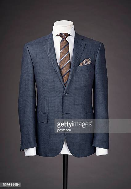 men business suit on grey background - krawatte stock-fotos und bilder