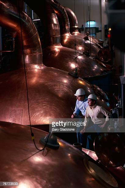 Men by copper vats