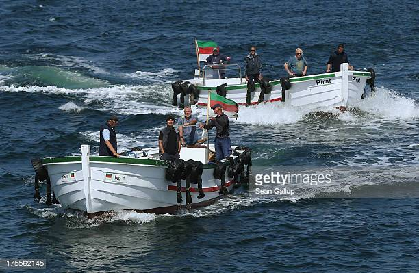 Men called Dampferboerte who earn their living by operating boats that ferry tourists to and from arriving passenger ships head out to meet an...