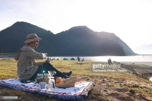 men camping by the hills in the morning drink coffee - coffee drink stock pictures, royalty-free photos & images