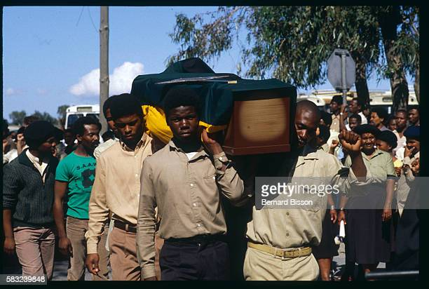 Men carry a coffin at the funeral of a 16yearold young man | Location Gugulethu South Africa