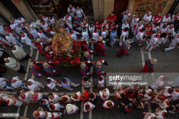 Men carry a figure of San Fermin during the San Fermin procession on the second day of the San Fermin Running of the Bulls festival on July 7 2018 in...