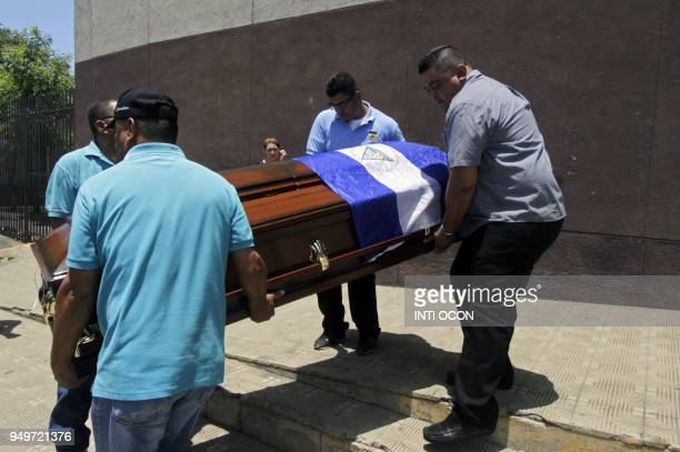 Men carry Alvaro Conrado's coffin a high school student killed during a protest against government's reforms in the Institute of Social Security in...