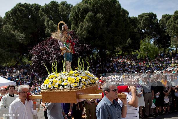 Men carry an image of 'San Isidro Labrador' for a mass at Pradera de San Isidro park during the San Isidro festivities on May 15 2014 in Madrid Spain...