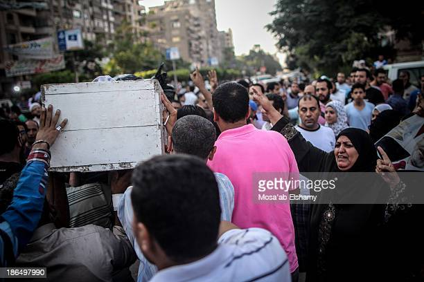 Men carry away coffin of a Morsi supporter killed during the violent clearing of Rabaa Adaweya camp.