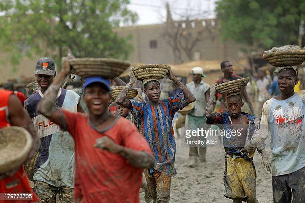 Men carry mud to Great Mosque, Djenne, Mali